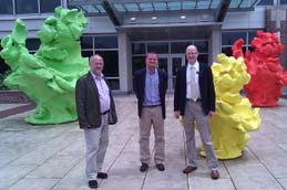 (L to R) Professor Victor Jongeel, Dr Roy Sleator and Dr Paul Walsh at the Genomics Institute of University of Illinois at Champagne Urbana. The green, yellow and red sculptures represent the resolved three dimensional structures of the ribosomes representing the three domains of life: Eukaryota, Bacteria and Achaea (a new kingdom of life defined by Carl Woose in 1977 – Woose is currently professor of microbiology at the University of Illinois at Urbana-Champaign).