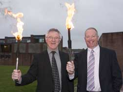 Dr Barry O'Connor, Registrar  & Vice President for Academic Affairs; and Dan Collins, Academic Administration & Student Affairs Manager; carrying the torch for CIT at the recent Students' Societies & Activities Award Ceremony.